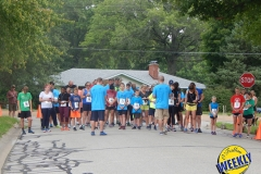 Before the race, the runners take time to pray and bless the 5K. WEB
