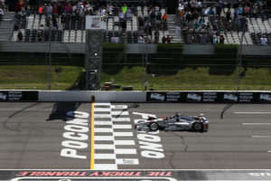 Will Power takes the twin checkers to win the ABC Supply 500 at Pocono Raceway (Photo by INDYCAR Photo – Chris Jones)