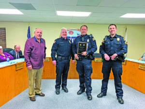 Officer Brandon Smiley was recognized as Shiloh's 2018 Officer of the Year at the Village Board meeting on Monday. Pictured from left: Mayor Jim Vernier, Chief Rich Wittenauer, Smiley, and Sergeant Jerod Allen.  (O'Fallon Weekly Photo by Annabelle Knef)